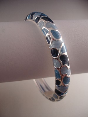 Silver Tone Bangle Bracelet with Blue Animal Print Ornament, Spring Lock