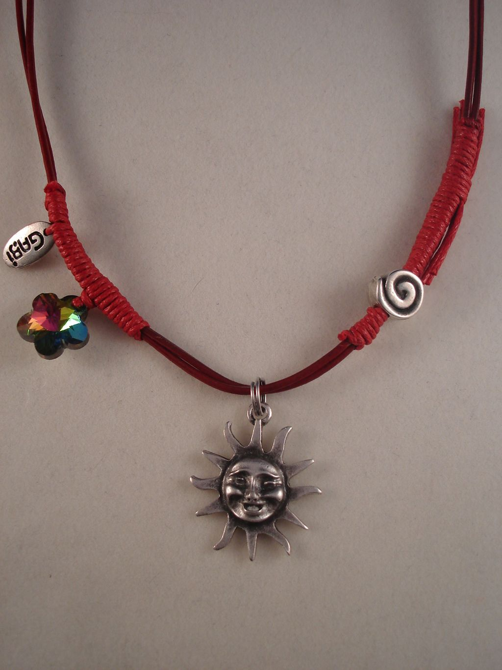 Smiling Sun Metal Pendant, Burgundy Leather Necklace